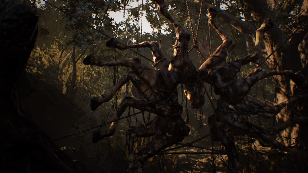 A gruesome spindle of horse legs, hung together from trees by rope to resemble a saw blade.